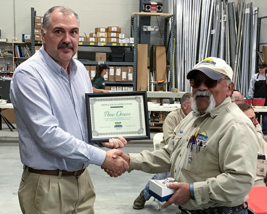 Rolling Hills Manager awards certificate to employee